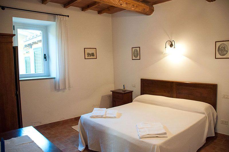 Camera matrimoniale in casa vacanze a Torgiano - Corcoro