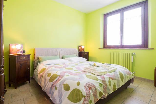 Camera in appartamento vacanza Robinia a Montecchio